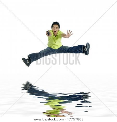 One very happy energetic man jumping into the air with reflection