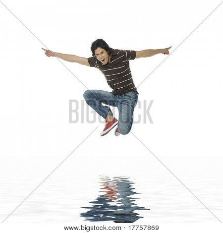 Reflection for One very happy energetic man jumping into the air