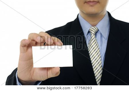 Businessman showing his business carr, focus on fingers and card.