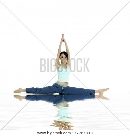 beautiful young woman practicing yoga with reflection