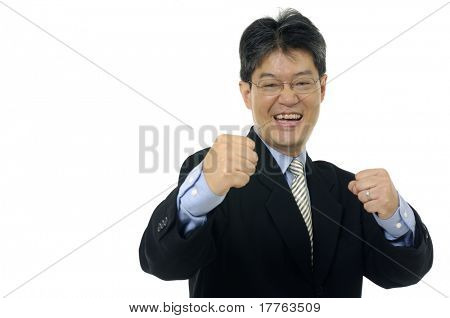 Very happy businessman with his arms raised