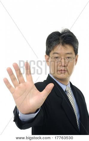 Businessman's hand making a stop sign