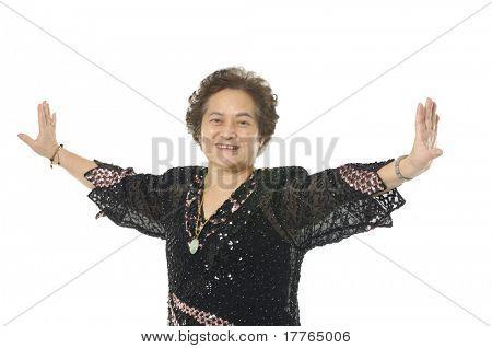 Senior woman make's taiji chuan exercise in studio