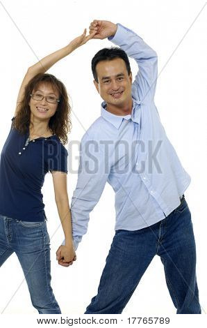 young couple holding hands over white