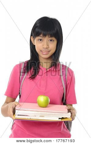 Girl holding apples on book with a smile