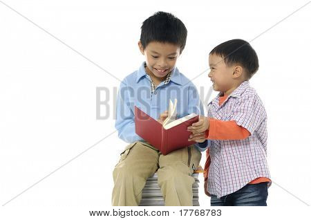 Little cute two boy with many books isolated