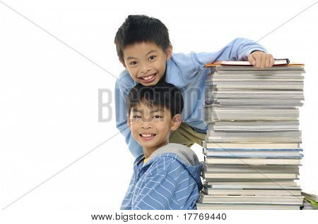 Little cute two boy with set of books having fun together