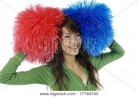 Young cheerleader with red and blue pom-poms smiling at camera isolated