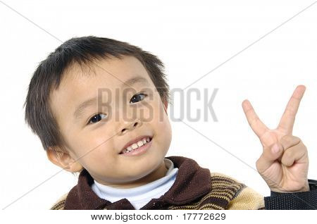 portrait of a cute little boy smiling -two fingers of kid's hand isolated