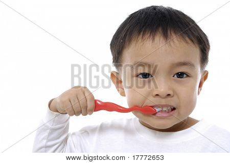 a beautiful little boy cleans your teeth- close up