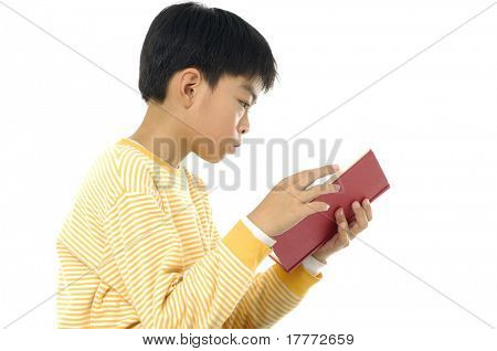 Child reading book isolated