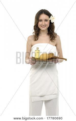 Woman holding a tray with lotion and washtub, spoon