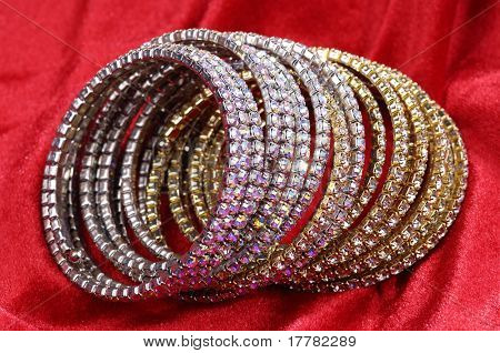 Fashion bracelets on red background