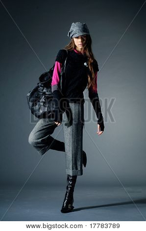 Young fashion model posing in the studio