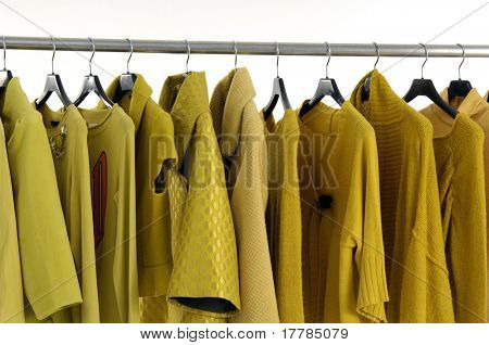 fashion yellow clothing hanging as display