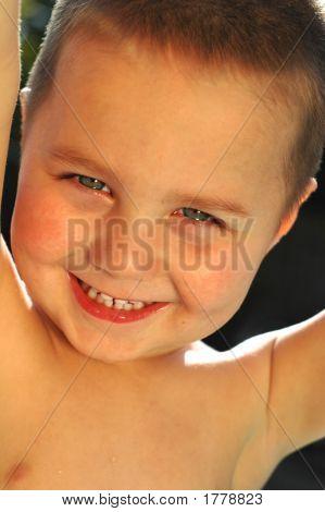 Backlit Portrait Of A Young Boy