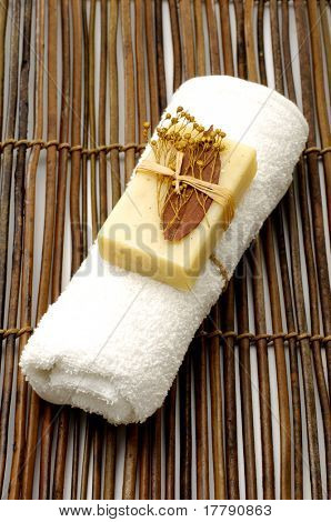 natural soap on roller towel on the bamboo mat