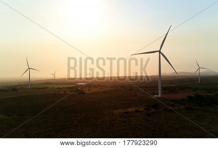 Harnessing wind power at energy production generating farm, clean