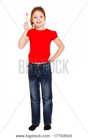 Happy little girl in red t-shirt holding toothbrush in hand