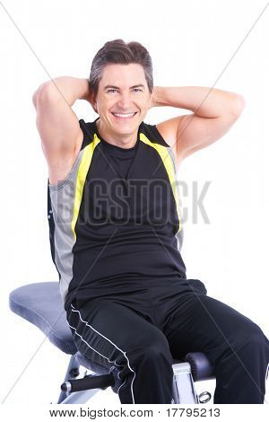 Smiling strong man working out. Isolated over white background