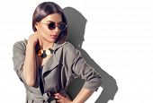 Beauty Fashion brunette model girl wearing stylish coat and sunglasses. Sexy woman portrait with per poster