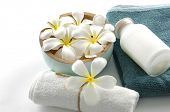 pic of white flower  - Relaxing spa scene with a white rolled up towel - JPG