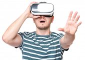 Amazed man wearing virtual reality goggles watching movies or playing video games, isolated on white poster