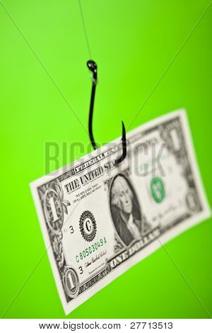 Dollar sign on piece of paper on hook