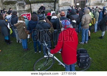 The Audience Watch Billy Bragg Perform In Front Of Exeter Cathedral At The Occupy Exeter Camp. 16/12