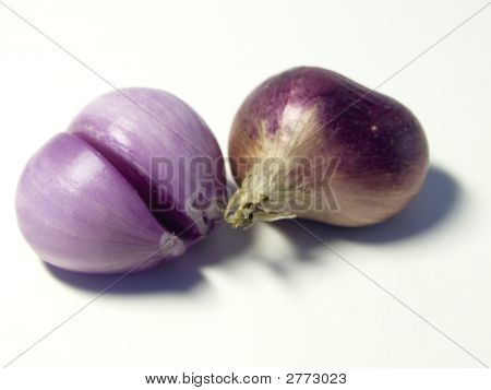 Peeled And Unpeeled Shallots