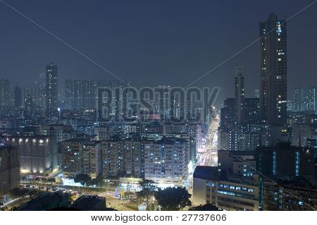 Hong Kong Downtown At Night With Highrise Buildings