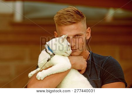 poster of Keeping His Cat Happy. Muscular Man Hold Cute Pedigree Cat. Happy Cat Owner With Muscular Look. Happ