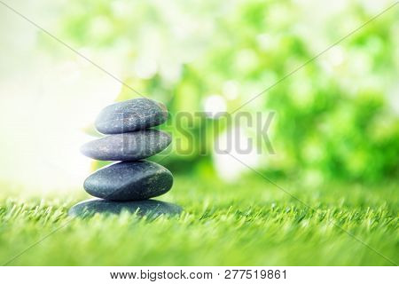 poster of Balance  With Pyramid Of Stone On Fresh Nature Green Grass  , Spa Meditation Or Well-being With Zen