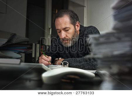 Businessman Writing On Papers