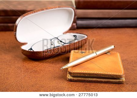 Notebook With  Leather Cover  Pen And Glasses