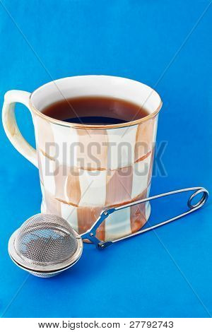 Cup Of Tea And Tea Infuser