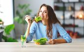 Healthy Eating. Happy Young Girl Eating Salad In The Morning In Kitchen poster