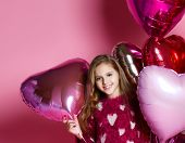 Beautiful Little Girl Celebrating Birthday Party With Big Pink Heart Balls. Family Celebration Of Th poster