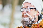 Portrait Of A Young Bearded Man Frozen In A Blizzard In The Woods. Face, Beard , Mustache And Glasse poster