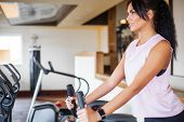 Concept Of Sport And Healthy Lifestyle. Exercising Legs Doing Cardio Workout On Cycling Bike poster