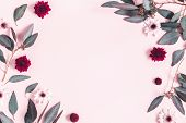 Flowers Composition. Eucalyptus Leaves And Pink Flowers On Pastel Pink Background. Flat Lay, Top Vie poster