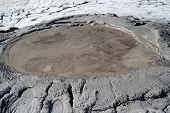 Sitting On The Edge Of The Crater Of A Mud Volcano, Berca, Romania. poster