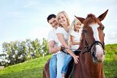 picture of saddle-horse  - Family on a horse - JPG