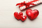 Valentine Background With Red Handmade Soap Hearts, Giftbox On White Rustic Wooden Planks. Happy Lov poster