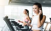 Girl Training In Gym And Listening To Music, Doing Cardio Exercise, Copy Space poster