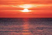 Sunrise Over The Ocean. Beautiful Seascape. Orange Sky Reflecting On Water At Dawn. Spiritual New Da poster