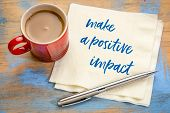 make a positive impact - handwriting on a napkin with a cup of coffee poster