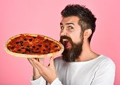Hungry Man Eating Tasty Pizza. Satisfied Man With Beard And Mustache Enjoying Delicious Pizza. Fast  poster