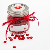 Glass Jar Filled With Cinnamon Heart Candies, With A Red Raffia Bow, A be Mine Sticker On The Silv poster
