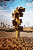 Man-made Wooden Bird Nest At Love Lake Dubai, Al Qudra Lakes. Dubai Love Lakes Is The Latest Tourist poster
